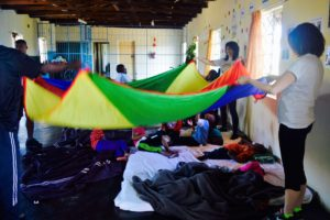 Crossing Countries Team having fun with parachute at Ikwhezi Welfare Organisation